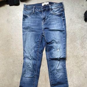Raw hem blue jeans